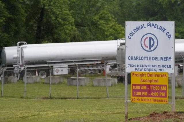 Tanker trucks are parked near the entrance of Colonial Pipeline Company Wednesday, May 12, 2021, in Charlotte, N.C.  The operator of the nation's largest fuel pipeline has confirmed it paid $4.4 million to a gang of hackers who broke into its computer systems. That's according to a report from the Wall Street Journal. Colonial Pipeline's CEO Joseph Blount told the Journal that he authorized the payment after the ransomware attack because the company didn't know the extent of the damage.   (AP Photo/Chris Carlson)