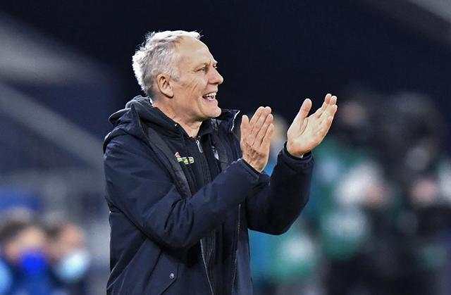 FILE - In this Wednesday, Dec. 16, 2020 file photo, Freiburg's head coach Christian Streich claps his hands during the German Bundesliga soccer match between FC Schalke 04 and SC Freiburg at the Arena in Gelsenkirchen, Germany. Freiburg coach Christian Streich shed tears and joined fans in the stadium after his team beat Augsburg 3-0 in the Bundesliga on Sunday Sept. 26, 2021. (AP Photo/Martin Meissner, Pool, File)