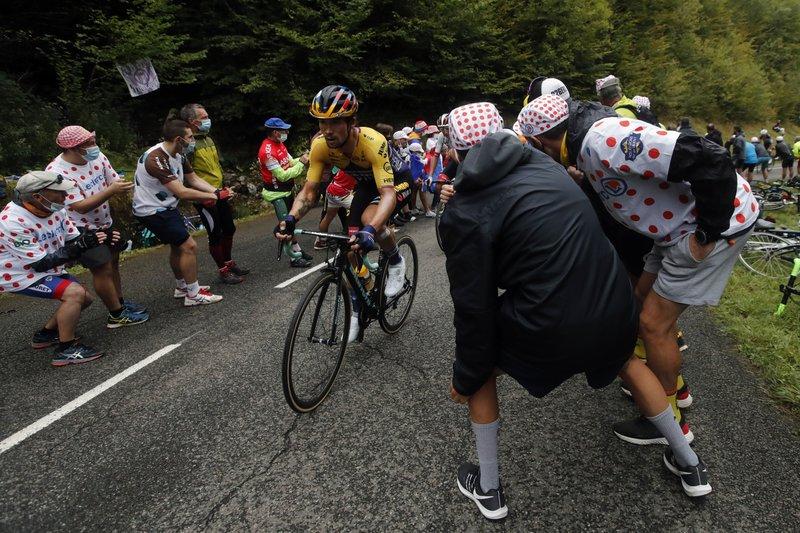 roglic leads tour de france after epic