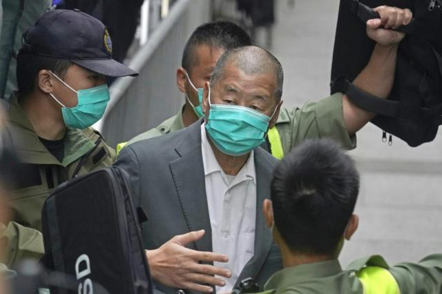 FILE - In this Feb. 9, 2021, file photo, democracy advocate Jimmy Lai, center, leaves the Hong Kong's Court of Final Appeal in Hong Kong. Lai was sentenced to more jail time Friday, May 28, 2021 over his role in an anti-government protest in 2019, as authorities crack down on dissent in the city. (AP Photo/Kin Cheung, File)