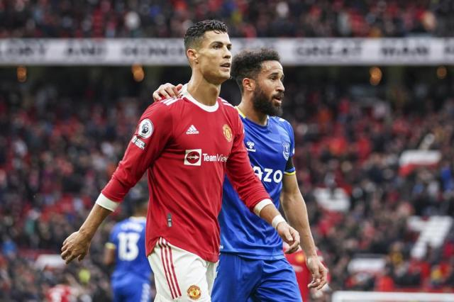 Manchester United's Cristiano Ronaldo and Everton's Andros Townsend walk off the pitch at the end of the English Premier League soccer match between Manchester United and Everton, at Old Trafford, Manchester, England, Saturday, Oct. 2, 2021. The match ended in a 1-1 draw. (AP Photo/Dave Thompson)