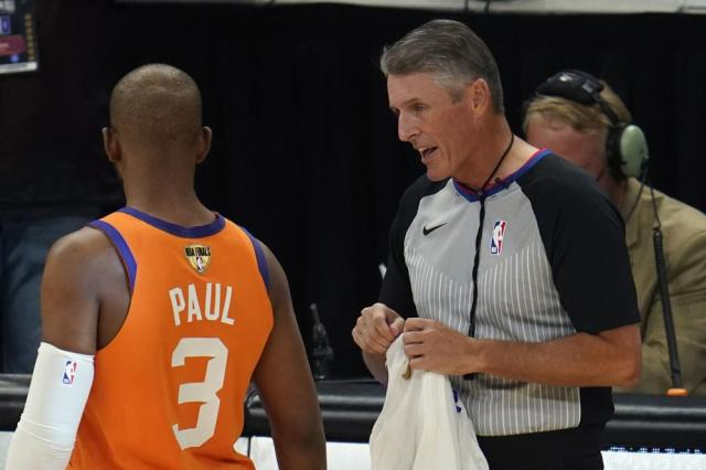 Referee Scott Foster talks with Phoenix Suns guard Chris Paul (3) before the start of Game 6 of basketball's NBA Finals against the Milwaukee Bucks in Milwaukee, Tuesday, July 20, 2021. (AP Photo/Paul Sancya)