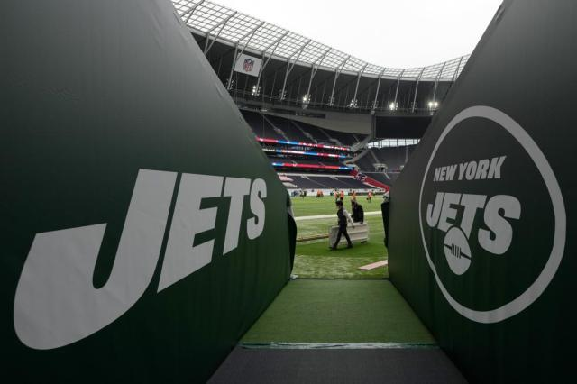 A view along the New York Jets tunnel as workers prepare the pitch in preparation to host NFL at the Tottenham Hotspur Stadium in London, Thursday, Oct. 7, 2021. After a one-year hiatus due to the pandemic, the NFL returns to London on Sunday when the Atlanta Falcons play the New York Jets at Premier League club Tottenham's $1.6 billion facility (AP Photo/Kirsty Wigglesworth)