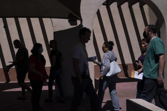 Voters arrive at a vote center to cast their ballots Tuesday, Sept. 14, 2021, in La Habra, Calif. With Gov. Gavin Newsom's fate at stake, Californians on Tuesday cast the last of the ballots that will decide whether he continues to lead them or if the nation's most populous state veers in a more conservative direction amid anger over his actions during the COVID-19 pandemic. (AP Photo/Jae C. Hong)