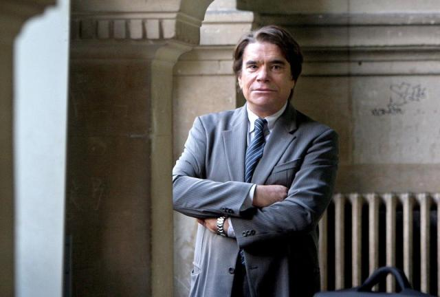 FILE - In this Oct. 19, 2005 file photo Bernard Tapie waits at the Paris courthouse at the start of his tax evasion case. Tapie, the charismatic president of French soccer club Marseille during its glory era whose reign was marred by a match-fixing scandal, died Sunday Oct. 3, 2021. He was 78. (AP Photo/Jacques Brinon, File)