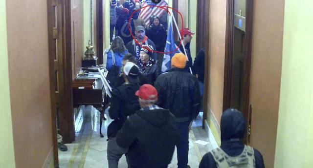 FILE - In this image taken from Capitol building security camera footage and released in a criminal complaint by the U.S. District Court for the District of Columbia, Derek Jancart, circled in red by the source, joins other rioters who stormed the U.S. Capitol on Jan. 6, 2021, in Washington. Outside pressures and internal strife are roiling two far-right extremist groups after members were charged in the attack on the U.S. Capitol. Former President Donald Trump's lies about a stolen 2020 election united an array of right-wing supporters, conspiracy theorists and militants on Jan. 6.  (U.S. District Court for the District of Columbia via AP, File)