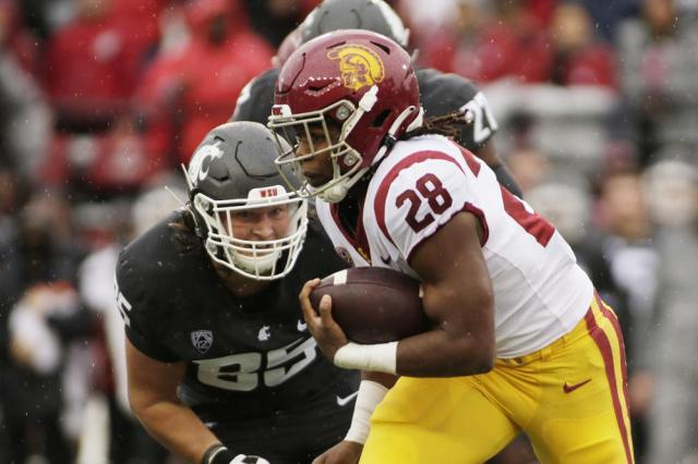 Southern California running back Keaontay Ingram (28) carries the ball while pursued by Washington State defensive end Andrew Edson (85) during the first half of an NCAA college football game, Saturday, Sept. 18, 2021, in Pullman, Wash. (AP Photo/Young Kwak)