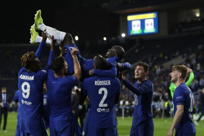 Chelsea players throw Chelsea's N'Golo Kante into the air as they celebrate winning the Champions League final soccer match between Manchester City and Chelsea at the Dragao Stadium in Porto, Portugal, Saturday, May 29, 2021. (AP Photo/Manu Fernandez, Pool)