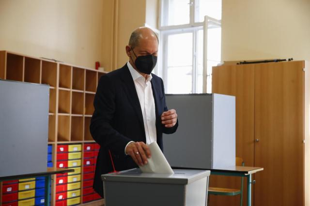 Social Democratic Party, SPD, candidate for chancellor Olaf Scholz casts his vote for the German parliament election in Potsdam, Berlin, Germany, Sunday, Sept. 26, 2021. (Wolfgang Rattay/Pool via AP)