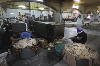 Kitchen at the Bangla Sahib Gurdwara now cooking 300,000 free meals a day to help feed  the growing ranks of the unfortunate