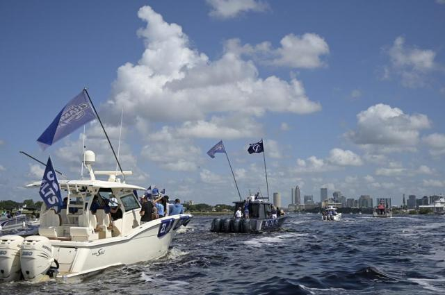 Boats carrying Tampa Bay Lightning players are viewed with the downtown skyline in the distance during the NHL hockey Stanley Cup champions' Boat Parade, Monday, July 12, 2021, in Tampa, Fla. (AP Photo/Phelan M. Ebenhack)