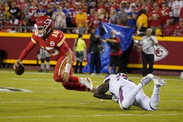 Kansas City Chiefs quarterback Patrick Mahomes, left, is stopped by Buffalo Bills defensive end Mario Addison during the first half of an NFL football game Sunday, Oct. 10, 2021, in Kansas City, Mo. (AP Photo/Ed Zurga)