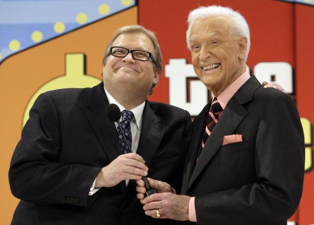"""FILE - The Price is Right show host, comedian Drew Carey, left, appears with longtime former host Bob Barker at the CBS Studio Center in Los Angeles on March 25, 2009. Barker, who retired and passed the microphone off to Carey, appeared on the show to promote his autobiography, """"Priceless Memories."""" The longest-running game show in television history is celebrating it's 50th season. (AP Photo/Damian Dovarganes, File"""