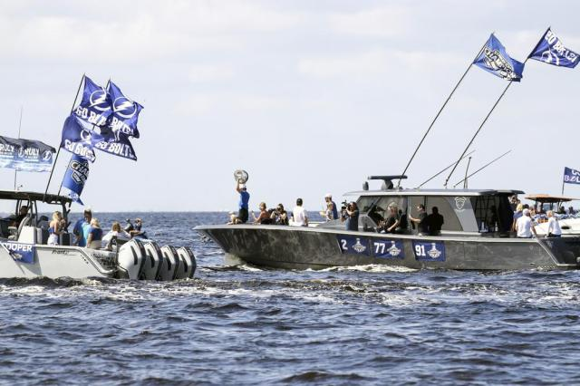 The Stanley Cup is held up as the Tampa Bay Lightning celebrate their NHL hockey Stanley Cup victory with a boat parade Monday, July 12, 2021 in Tampa, Fla. (Dirk Shadd/Tampa Bay Times via AP)