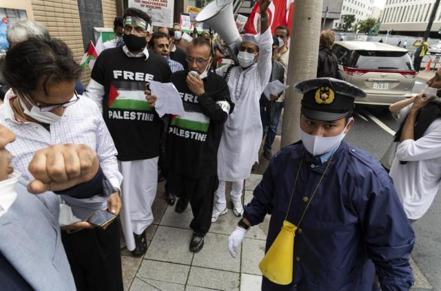 A group of Muslims from different countries living in Japan march towards the Israeli Embassy in Tokyo on Friday, May 21, 2021, as they protest against Israel fighting against Palestinians in the recent war in Gaza. (AP Photo/Hiro Komae)