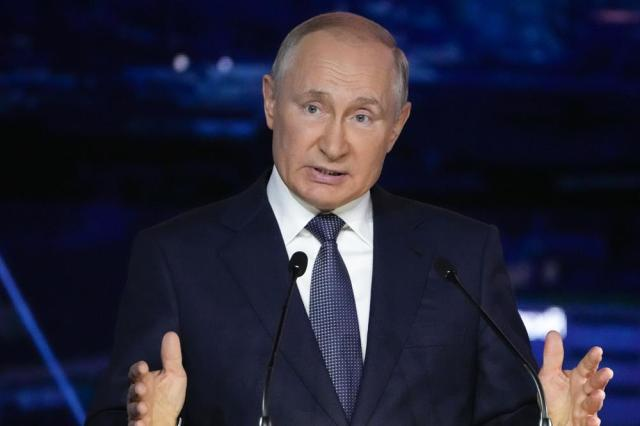 FILE - In this Sept. 3, 2021, file photo, Russian President Vladimir Putin gestures as he delivers his speech during a plenary session at the Eastern Economic Forum in Vladivostok, Russia. The embattled opposition groups admit the Kremlin has left them few options and resources ahead of the Sept. 19 election that is widely seen as a key to Putin's effort to cement his hold on power. But they still hope to erode the dominance of the ruling United Russia party in the State Duma, or parliament. (AP Photo/Alexander Zemlianichenko, Pool, File)