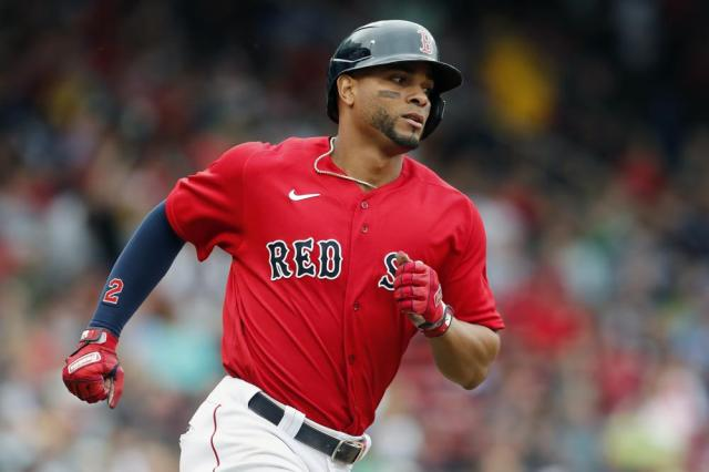 Boston Red Sox's Xander Bogaerts rounds the bases on his solo home run during the second inning of a baseball game, Saturday against the Philadelphia Phillies, July 10, 2021, in Boston. (AP Photo/Michael Dwyer)