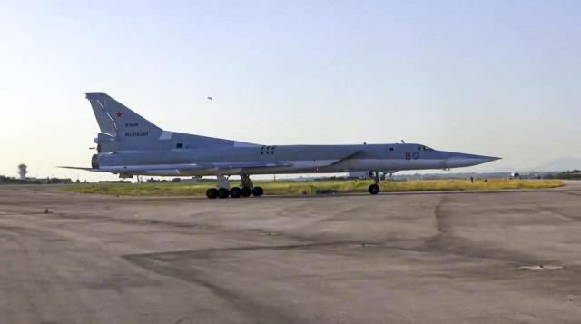In this photo taken from a video provided on Tuesday, May 25, 2021 by the Russian Defense Ministry Press Service, A Russian Tu-22M3 bomber lands at Hemeimeem air base in Syria. Russia's Defense Ministry said that three Tu-22M3 bombers have arrived at the Hemeimeem air base, located in Syria's coastal province of Latakia and the main hub for Moscow's operations in the country. The ministry said bomber crews would fly a series of training missions over the Mediterranean. (Russian Defense Ministry Press Service via AP, file)