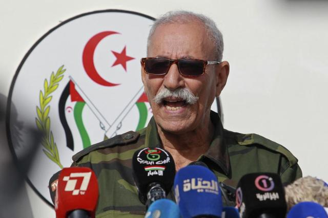 FILE - In this Feb. 27, 2021 file photo, Brahim Ghali, leader of the Polisario front, delivers a speech in a refugee camp near Tindouf, southern Algeria. Brahim Ghali, the leader of the Western Sahara independence movement at the heart of a diplomatic spat between Spain and Morocco, will appear before an investigating judge in Spain on June 1, 2021. Ghali, who has been recovering from COVID-19 in a Spanish hospital, faces a probe for possible genocide and a lawsuit for alleged tortures. (AP Photo/Fateh Guidoum, File)