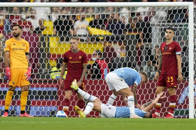 Lazio's Sergej Milinkovic-Savic, on the ground reacts after scoring the opening goal during a Serie A soccer match between Lazio and Roma, at Rome's Olympic Stadium, Sunday, Sept. 26, 2021. (AP Photo/Andrew Medichini)