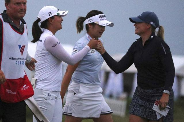 Jin Young Ko, left, and Matilda Castren bump fists at the end of the third round of the LPGA Volunteers of America Classic golf tournament in The Colony, Texas, Saturday, July 3, 2021. (AP Photo/Richard W. Rodriguez)