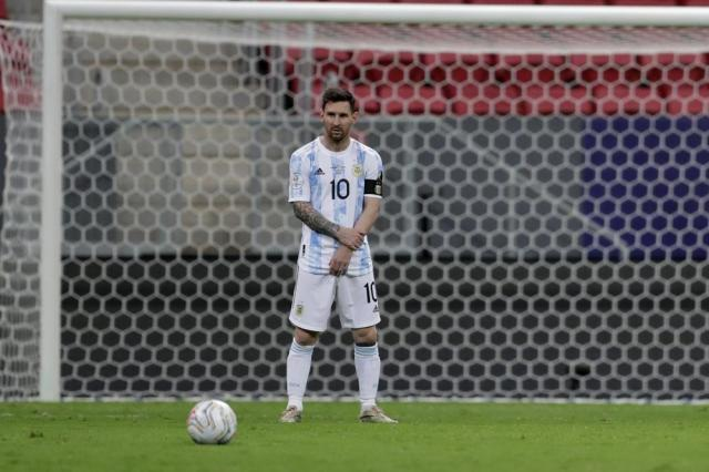 Argentina's Lionel Messi stands on the field during a Copa America semifinal soccer match against Colombia at the National stadium in Brasilia, Brazil, Tuesday, July 6, 2021. (AP Photo/Eraldo Peres)