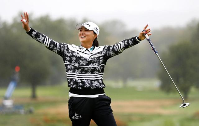 Jin Young Ko, of Korea, celebrates after winning the Cognizant Founders Cup, Sunday, Oct. 10, 2021, in West Caldwell, N.J. (AP Photo/Noah K. Murray)