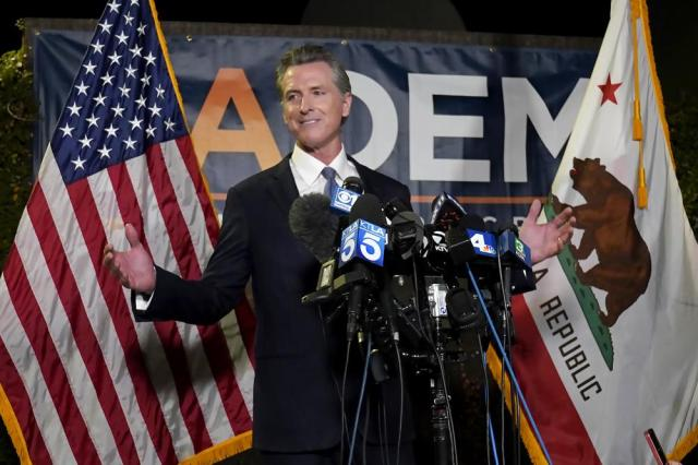 California Gov. Gavin Newsom addresses reporters after beating back the recall attempt that aimed to remove him from office, at the John L. Burton California Democratic Party headquarters in Sacramento, Calif., Tuesday, Sept. 14, 2021. Millions were spent on the recall election but in the end Newsom easily defeated the attempt to send him into early retirement. California's Republicans have not won a statewide race since 2006. (AP Photo/Rich Pedroncelli)