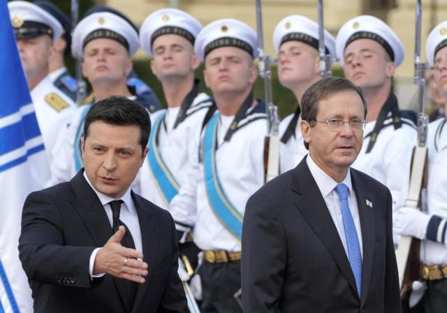 Ukrainian President Volodymyr Zelenskyy, left, and Israeli President Isaac Herzog review the honor guard during a welcome ceremony ahead of their meeting in Kyiv, Ukraine, Tuesday, Oct. 5, 2021. (AP Photo/Efrem Lukatsky)