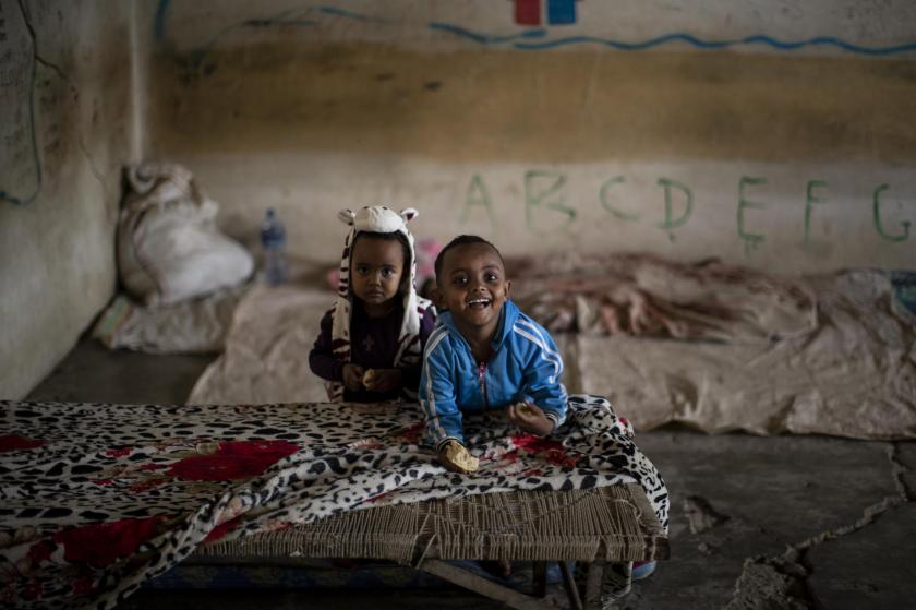 Young Tigrayan children play in a classroom where they now live at a camp for the internally-displaced in an elementary school in Mekele, in the Tigray region of northern Ethiopia Monday, May 10, 2021. Despite claims by both Ethiopia and Eritrea that they were leaving, Eritrean soldiers are in fact more firmly entrenched than ever in Tigray, The Associated Press has found. (AP Photo/Ben Curtis)