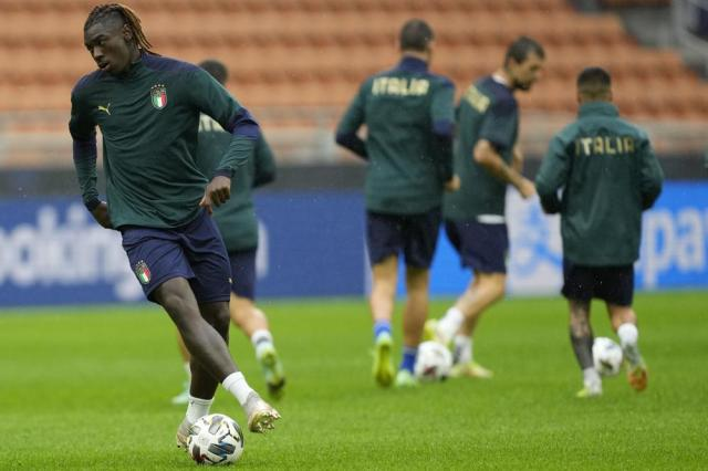 Italy's Moise Kean attends a training session ahead of Wednesday's UEFA Nations League semifinal soccer match between Italy and Spain, at the Milan San Siro stadium, Italy, Tuesday, Oct. 5, 2021. (AP Photo/Antonio Calanni)
