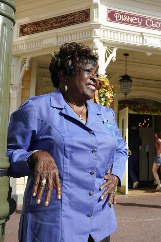 """50 year employee Earliene Anderson stands on Main Street at the Magic Kingdom theme park at Walt Disney World Monday, Aug. 30, 2021, in Lake Buena Vista, Fla. """"Disney has been my love, and it still is,"""" Anderson said recently before starting her shift in merchandising. (AP Photo/John Raoux)"""