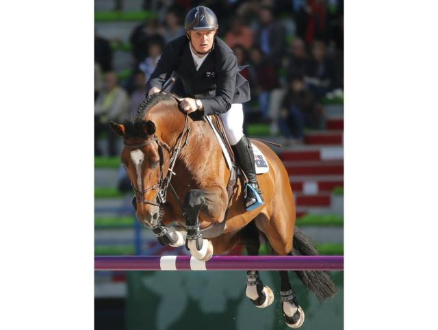 FILE - In this Sept. 3, 2014, file photo, Jamie Kermond of Australia, riding Quite Cassini competes during the second day of the team and individual qualifying show jumping event at the FEI World Equestrian Games in Caen, western France. Equestrian Australia said Wednesday, July 21, 2021, it had provisionally suspended Kermond, a member of the Olympic show jumping team over a positive test for cocaine. (AP Photo/Michel Euler, File)