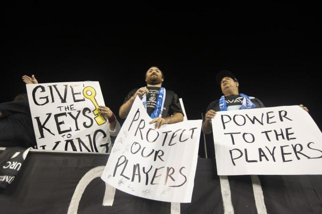 Fans hold signs in support of players, during an NWSL soccer match between NJ/NY Gotham FC and the Washington Spirit on Wednesday, Oct. 6, 2021, in Chester, Pa. (Charles Fox/The Philadelphia Inquirer via AP)