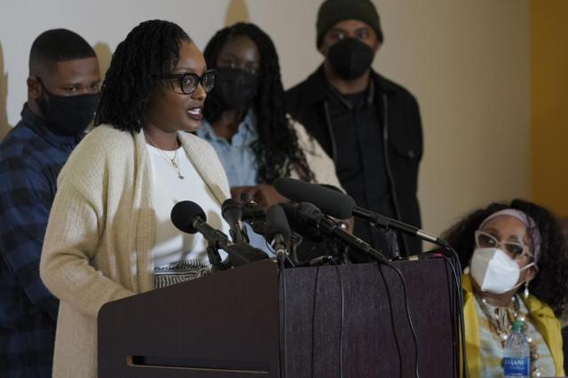 """Monet Carter-Mixon, the sister of Manuel """"Manny"""" Ellis, speaks Thursday, May 27, 2021, at a news conference in Tacoma, Wash., south of Seattle. Ellis died on March 3, 2020 after he was restrained by police officers. Earlier in the day Thursday, Washington state attorney general filed criminal charges against three police officers in the death of Ellis. (AP Photo/Ted S. Warren)"""