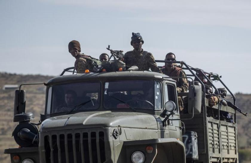 """FILE - In this Saturday, May 8, 2021 file photo, Ethiopian government soldiers ride in the back of a truck on a road near Agula, north of Mekele, in the Tigray region of northern Ethiopia. The United States said Thursday, Aug. 12, 2021 it is sending a special envoy to Ethiopia as the fast-moving conflict in the Tigray region has spread into neighboring regions and Ethiopia's government this week called on all able citizens to stop the resurgent Tigray forces """"once and for all."""" (AP Photo/Ben Curtis, File)"""