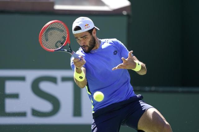 Matteo Berrettini, of Italy, returns a shot to Alejandro Tabilo, of Chile, at the BNP Paribas Open tennis tournament Sunday, Oct. 10, 2021, in Indian Wells, Calif. (AP Photo/Mark J. Terrill)