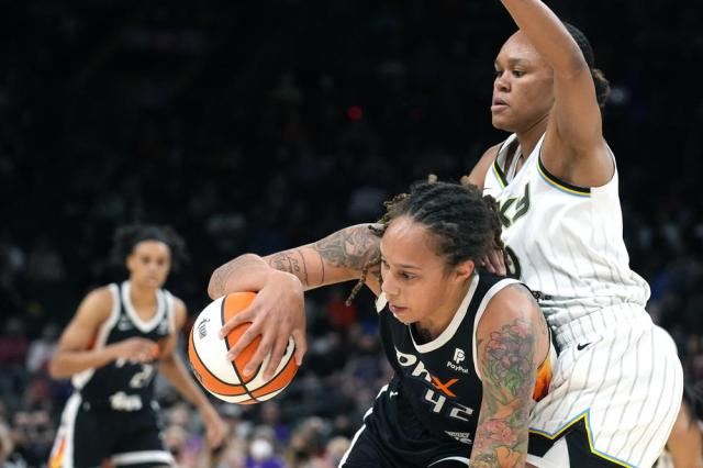 Phoenix Mercury center Brittney Griner (42) shields Chicago Sky center Azurá Stevens from the ball during the first half of Game 2 of basketball's WNBA Finals, Wednesday, Oct. 13, 2021, in Phoenix. (AP Photo/Rick Scuteri)
