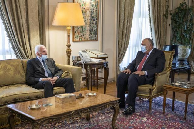 Egyptian Foreign Minister Sameh Shoukry, right, meets with Palestinian Fatah official Azzam Al-Ahmad at the foreign ministry in Cairo, Thursday, May 20, 2021. (AP Photo/Nariman El-Mofty)