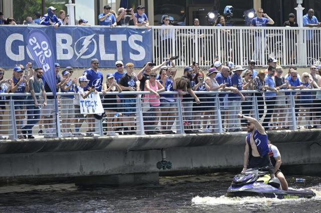 Tampa Bay Lightning defenseman Erik Cernak acknowledges fans from a personal watercraft during the NHL hockey Stanley Cup champions' Boat Parade, Monday, July 12, 2021, in Tampa, Fla. (AP Photo/Phelan M. Ebenhack)