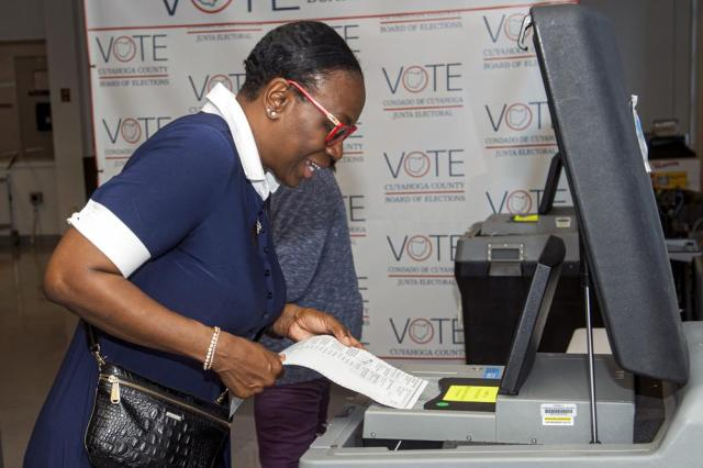 In this July 7, 2021, photo Nina Turner, a candidate running in a special Democratic primary election for Ohio's 11th Congressional District loads her ballot into a tabulating machine at the Cuyahoga County Board of Elections in Cleveland. (AP Photo/Phil Long)
