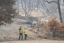 Evacuations lifted near California fires, some go home