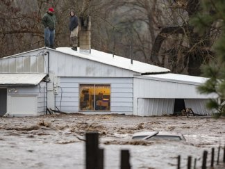 Rescues by chopper, front loader as flood hits northwest US