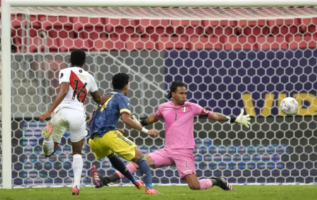 Colombia's Luis Diaz, center, scores his side's second goal against Peru during the Copa America third place soccer match at the National stadium in Brasilia, Brazil, Friday, July 9, 2021. (AP Photo/Eraldo Peres)