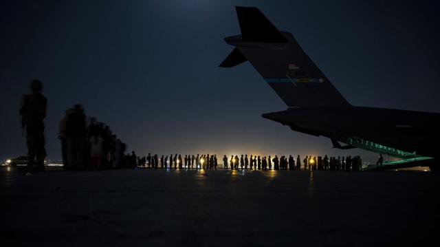 FILE - In this Aug. 21, 2021, file image provided by the U.S. Air Force, U.S. Air Force aircrew, assigned to the 816th Expeditionary Airlift Squadron, prepare to load qualified evacuees aboard a U.S. Air Force C-17 Globemaster III aircraft in support of the Afghanistan evacuation at Hamid Karzai International Airport, Kabul, Afghanistan. An Afghan man who worked for the U.S. government in Afghanistan says the Biden administration has ignored his pleas for help to evacuate his two young sons from Afghanistan after their mother died of a heart attack while being threatened by the Taliban. The International Refugee Assistance Project on Thursday, Oct. 7, 2021 filed a lawsuit against Secretary of State Antony Bilken on the man's behalf. The father fears for his children's safety and asked that he be identified only by his first name, Mohammad. (Senior Airman Taylor Crul/U.S. Air Force via AP, File)