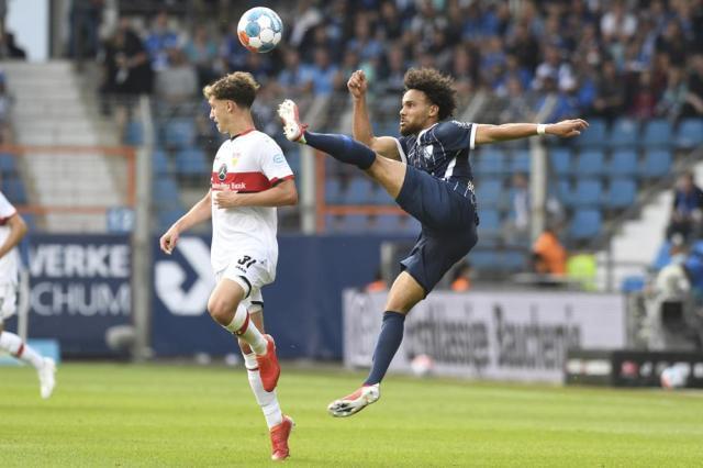 Stuttgart's Mateo Klimowicz, left, and Bochum's Herbert Bockhorn vie for the ball during their Bundesliga soccer match in Bochum, Germany, Sunday, Sept. 26, 2021. (Bernd Thissen/dpa via AP)