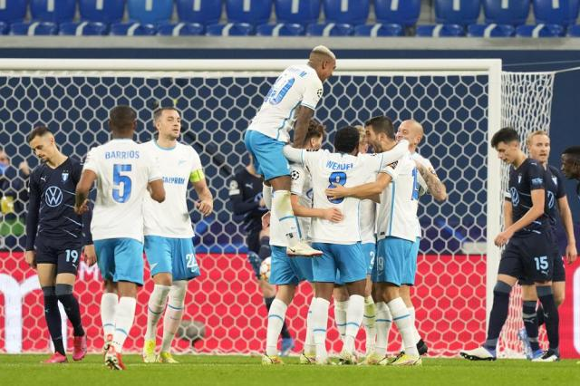 Zenit players celebrate their team's second goal scored by Zenit's Daler Kuzyaev during the Champions League, group H, soccer match, between Zenit St. Petersburg and Malmo at the Gazprom Arena in St.Petersburg, Russia, Wednesday, Sept. 29, 2021. (AP Photo/Dmitry Lovetsky)