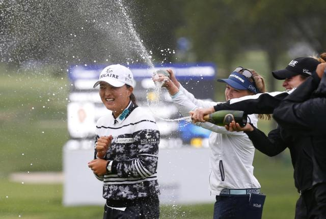 Jin Young Ko, left, of South Korea, is sprayed by Brooke Henderson and Gabby Lopez after winning the Cognizant Founders Cup, Sunday, Oct.10, 2021, in West Caldwell, N.J. (AP Photo/Noah K. Murray)
