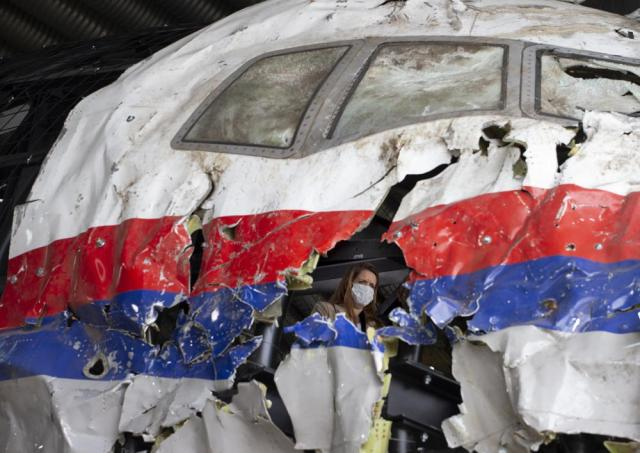 Trial judges and lawyers view the reconstructed wreckage of Malaysia Airlines Flight MH17, at the Gilze-Rijen military airbase, southern Netherlands, Wednesday, May 26, 2021. (AP Photo/Peter Dejong, Pool)