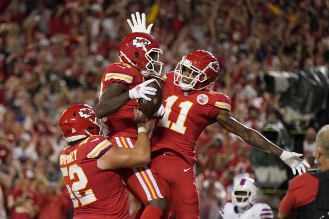 Kansas City Chiefs wide receiver Byron Pringle, center, is congratulated by teammates Demarcus Robinson (11) and Creed Humphrey (52) after catching a touchdown pass during the first half of an NFL football game against the Buffalo Bills Sunday, Oct. 10, 2021, in Kansas City, Mo. (AP Photo/Charlie Riedel)